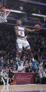 SACRAMENTO, CA - MARCH 23: De'Aaron Fox #5 of the Sacramento Kings dunks against the Phoenix Suns on March 23, 2019 at Golden 1 Center in Sacramento, California. NOTE TO USER: User expressly acknowledges and agrees that, by downloading and or using this photograph, User is consenting to the terms and conditions of the Getty Images Agreement. Mandatory Copyright Notice: Copyright 2019 NBAE (Photo by Rocky Widner/NBAE via Getty Images)