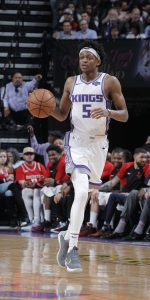 SACRAMENTO, CA - APRIL 2: De'Aaron Fox #5 of the Sacramento Kings brings the ball up the court against the Houston Rockets on April 2, 2019 at Golden 1 Center in Sacramento, California. NOTE TO USER: User expressly acknowledges and agrees that, by downloading and or using this photograph, User is consenting to the terms and conditions of the Getty Images Agreement. Mandatory Copyright Notice: Copyright 2019 NBAE (Photo by Rocky Widner/NBAE via Getty Images)
